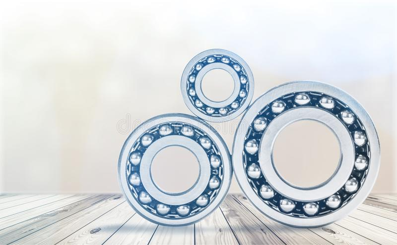 Ball bearings, pinions on background. Ball pinion bearings pinions ball bearings background design royalty free stock photos