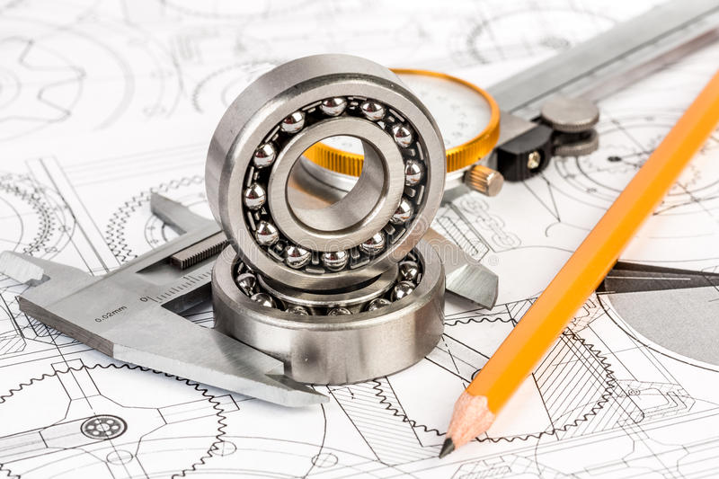 Ball bearings on technical drawing stock photography