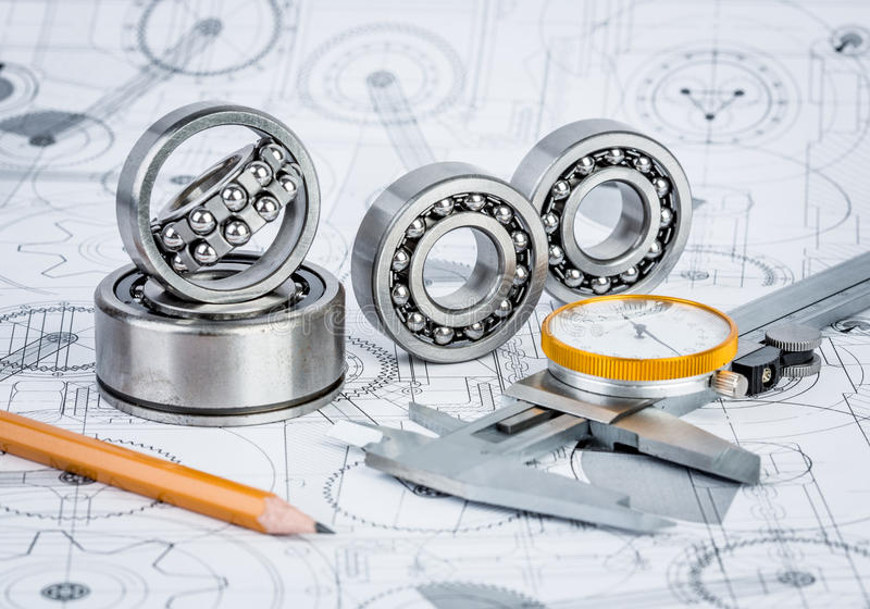 Ball bearings on technical drawing stock images