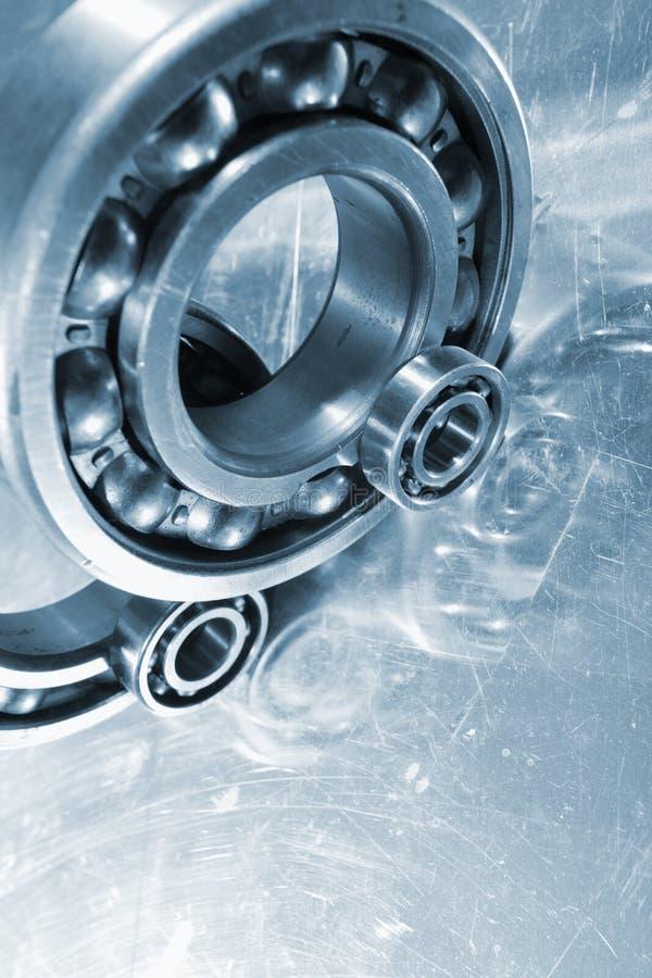 Ball bearings and titanium. Ball-bearings, pinions against a titanium background, duplex light-blue toning idea royalty free stock image