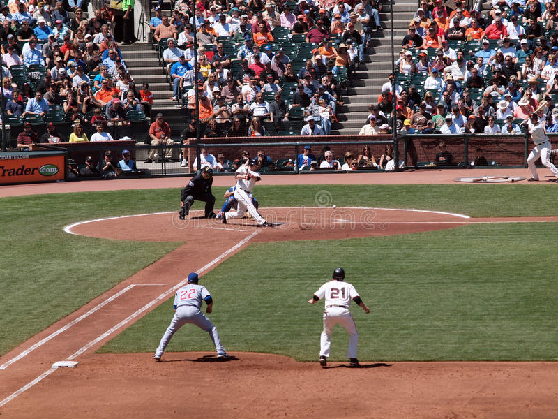 Ball bounces off ground as Aubrey Huff hits pitch. Giants Vs. Cubs: Ball bounces off the ground as Giants Aubrey Huff hits pitch with Freddy Sanchez taking lead royalty free stock image
