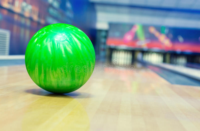 Bowling alley. Ball on bowling alley against ten pins stock photos