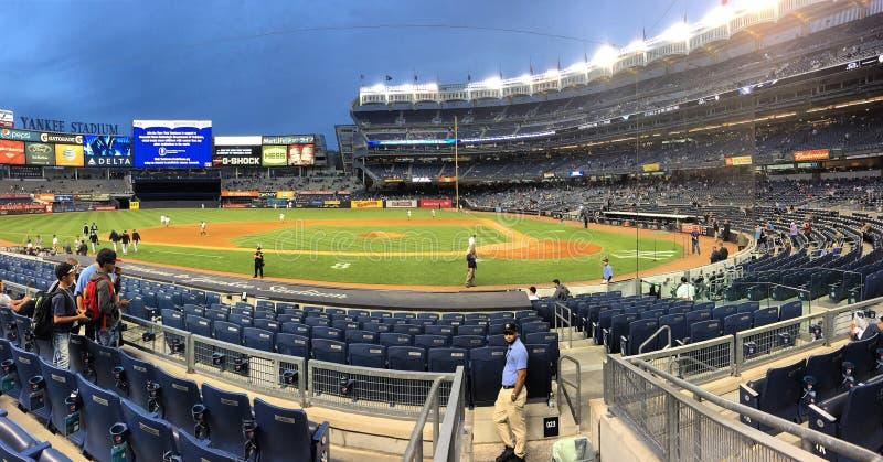 Ball In The Bronx. A crisp autumn evening in Yankee Stadium stock photos