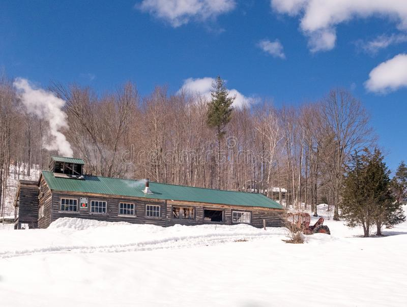 Ball Brook Maple Sugar Shack. In Pownal Vermont, in March, springtime harvest making syrup, New England with smokestacks and snow royalty free stock photography