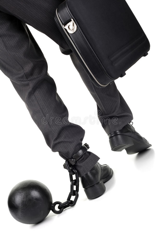 Ball and chain on businessman stock images