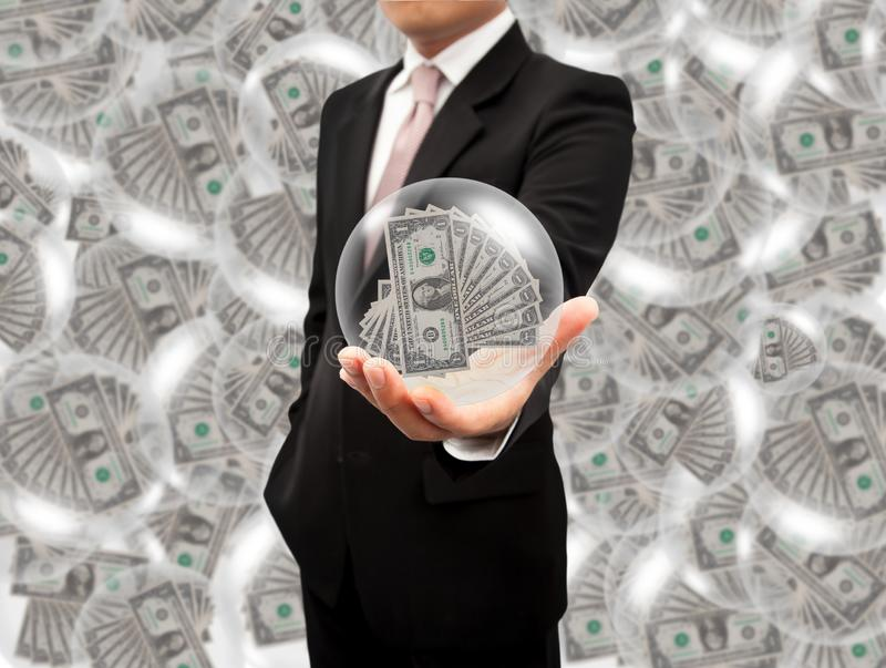 Ball dollars in the hands royalty free stock photo