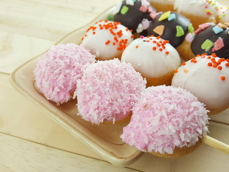 Ball donuts scatter over of colorful sugar. royalty free stock images