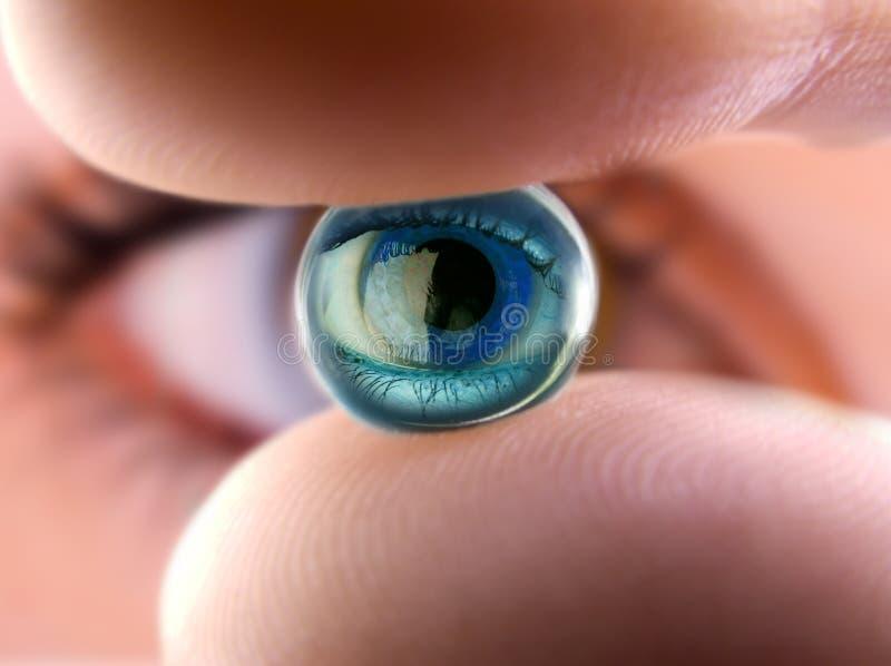 Ball of the eye 2. Small gel marble reflecting a woman eye. Macro shot stock image