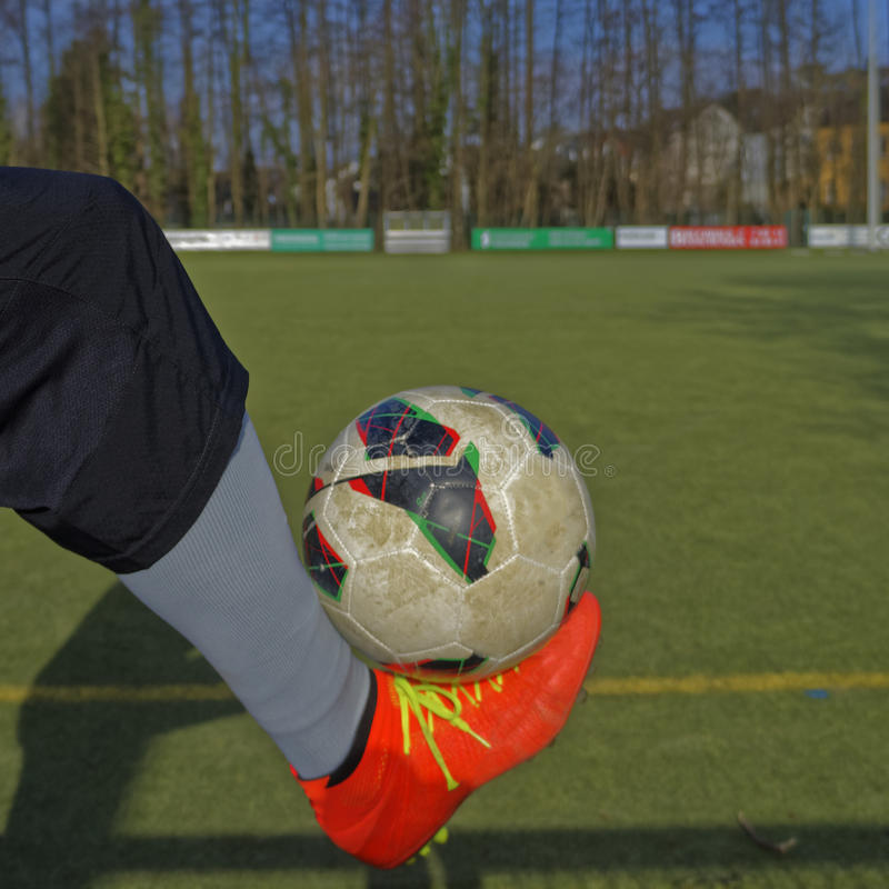 Ball on a foot royalty free stock image