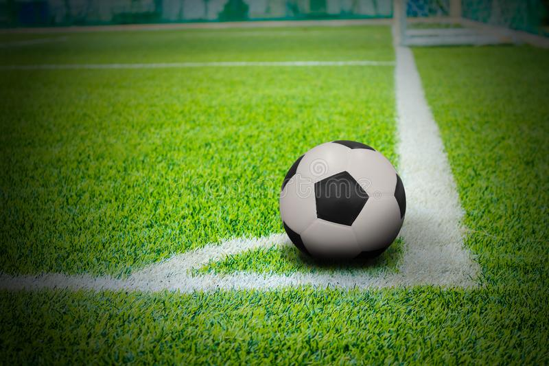 The ball in football field corner with artificial grass royalty free stock photography