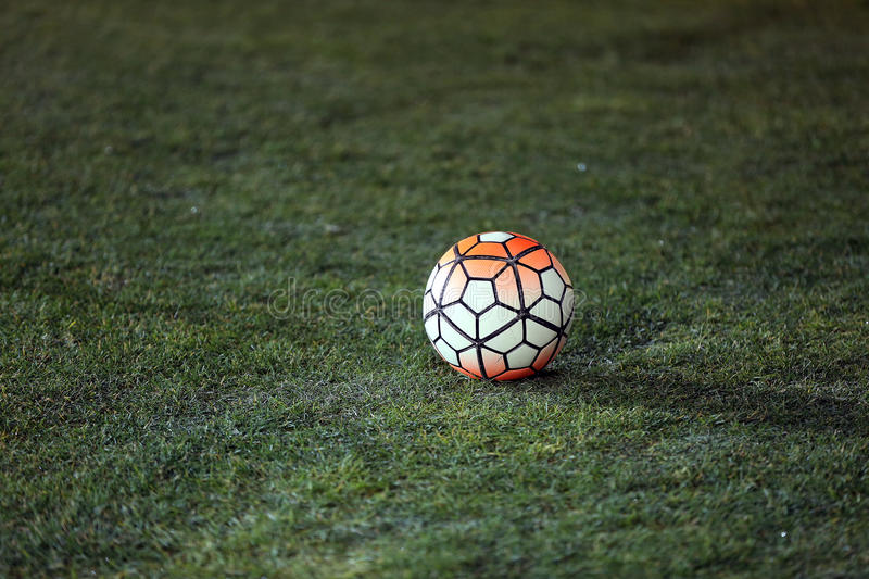 Ball on a football ground. Football ball on the ground, close-up night view stock photo