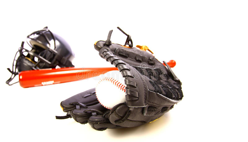 Ball, glove, bat, and helmet royalty free stock photo