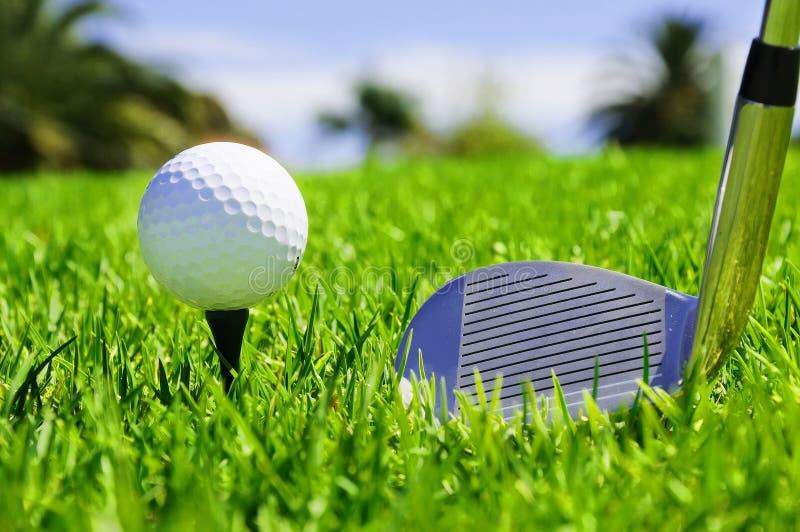 Ball and golf clubs stock photos