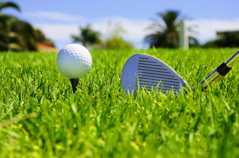 Ball and golf clubs. On the bright green grass - as a symbol of success royalty free stock photography