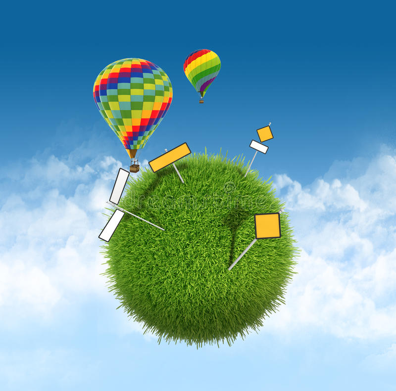 Ball of grass with road signs and balloons on the stock photos