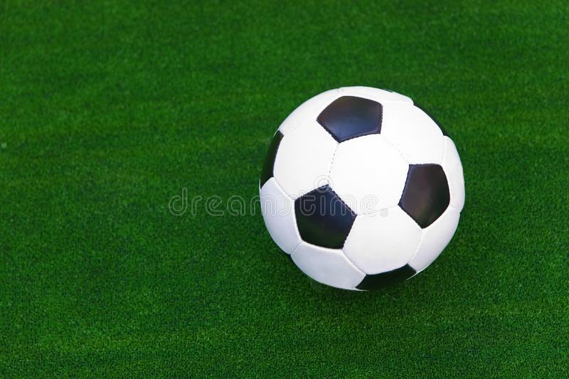 Ball in the green grass stock photo