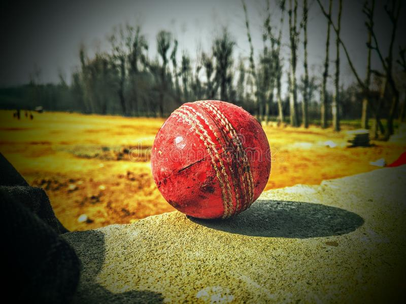 Ball in the ground. Red ball in ground at balcony vignetted stock images