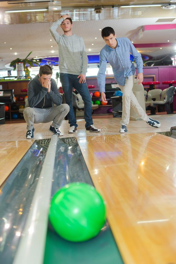 Ball in the gutter. Three royalty free stock photography