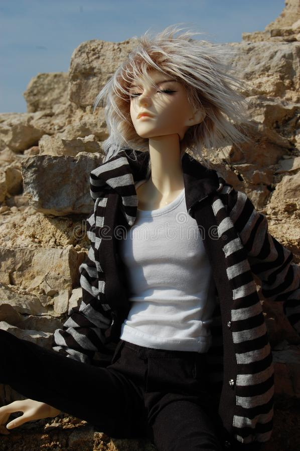 Download Ball-jointed Doll With Squinting Glance Sitting Stock Image - Image: 12810305