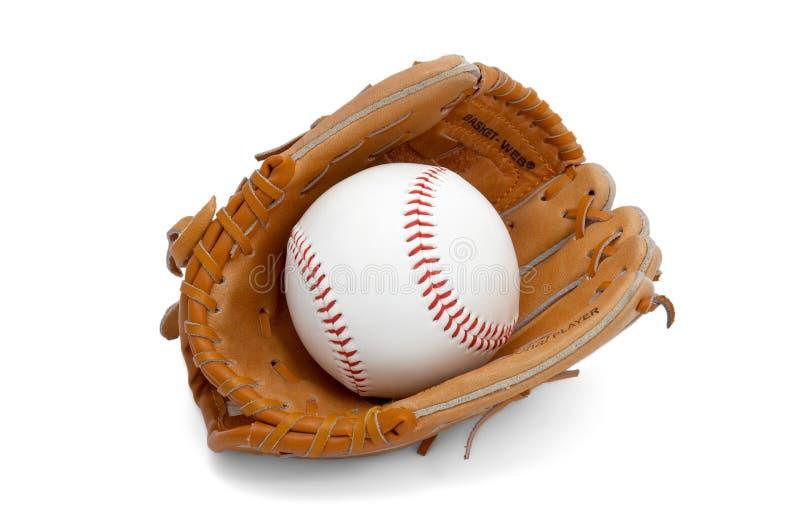 Ball in kids glove stock image