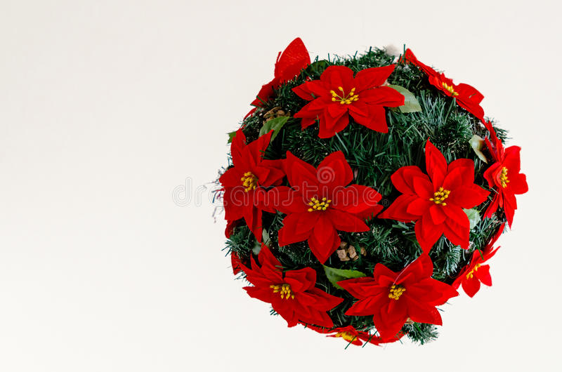 Ball made of fir branches with red flowers. Christmas Decor stock photo