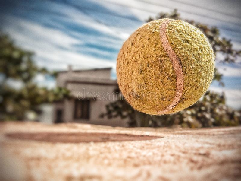 Ball mid air in sharp focus stock photos