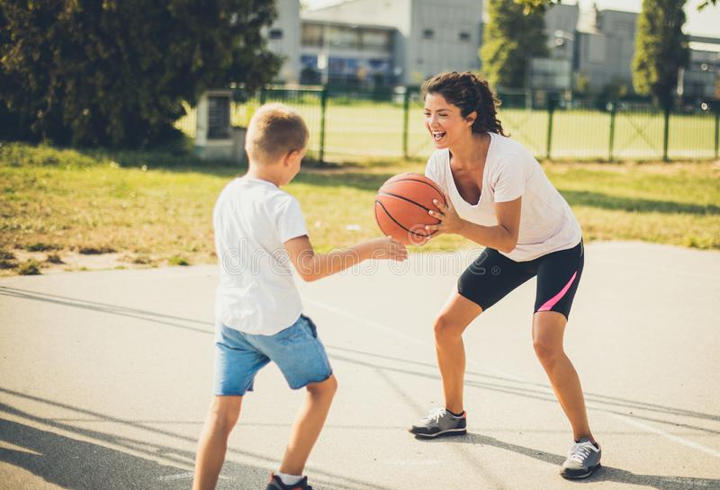 Ball is my. Mother and son playing basketball royalty free stock photo