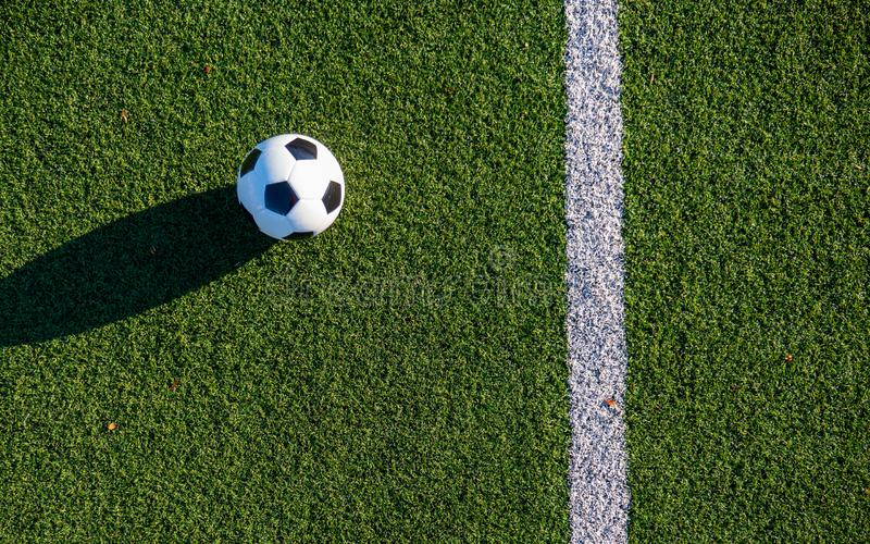 The ball next to the end line of the green football field. Shot from above. The ball next to the end line of the green football field stock photography