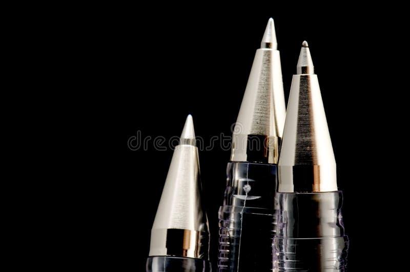 Ball pen on black royalty free stock image