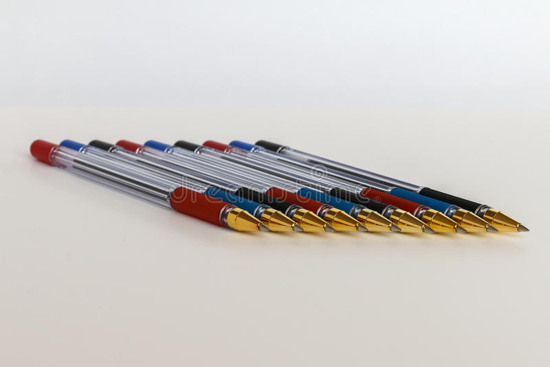 Ball pens of different flowers. On a white background royalty free stock photography
