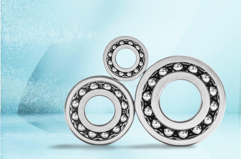 Ball bearings, pinions on background. Ball pinion bearings pinions ball bearings background design stock photo