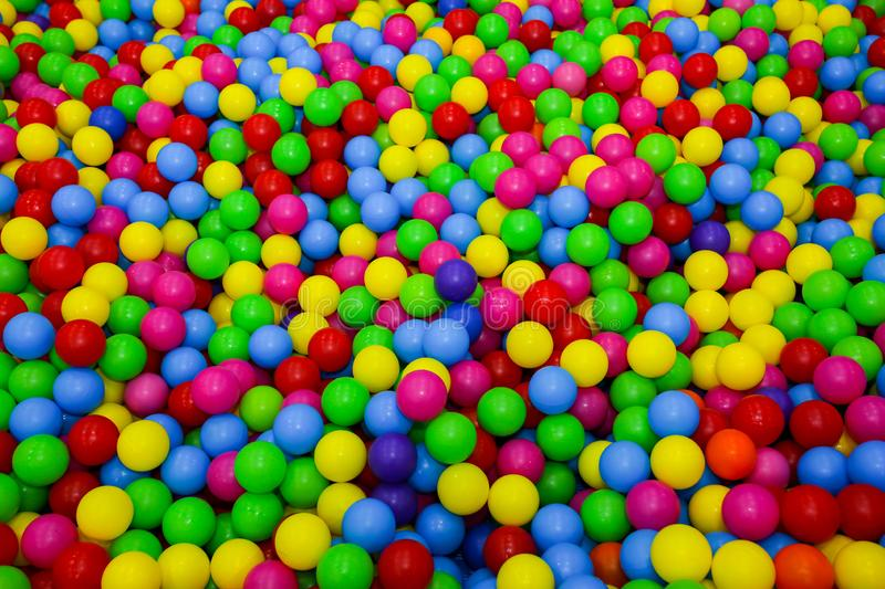 Ball pit with colorful plastic balls in children entertainment center. Pool with bright balls background. Fun, game, play stock image