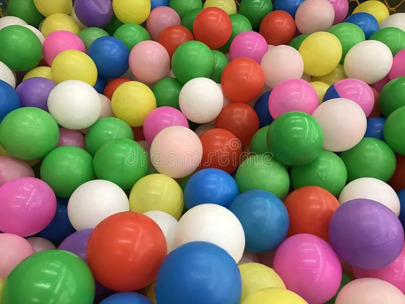 Ball pit. Colourful plastic balls in a children's ball play pit royalty free stock photography