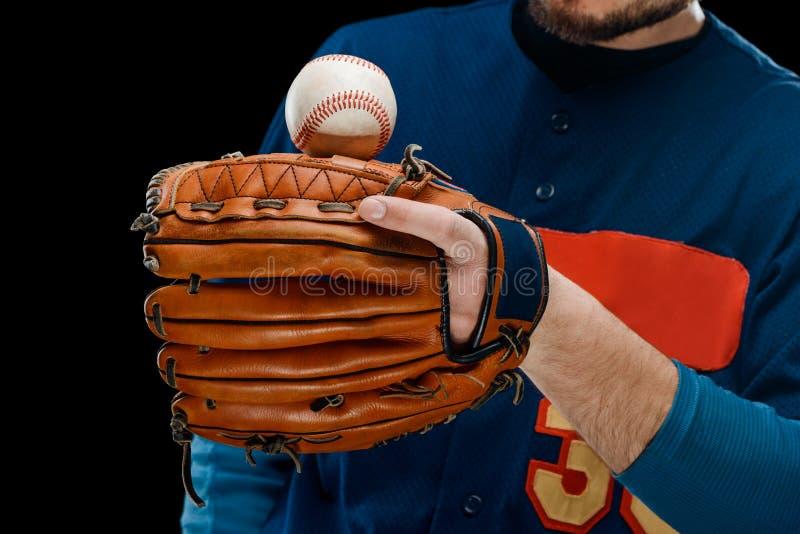Ball on pitcher`s leather mitt stock photos