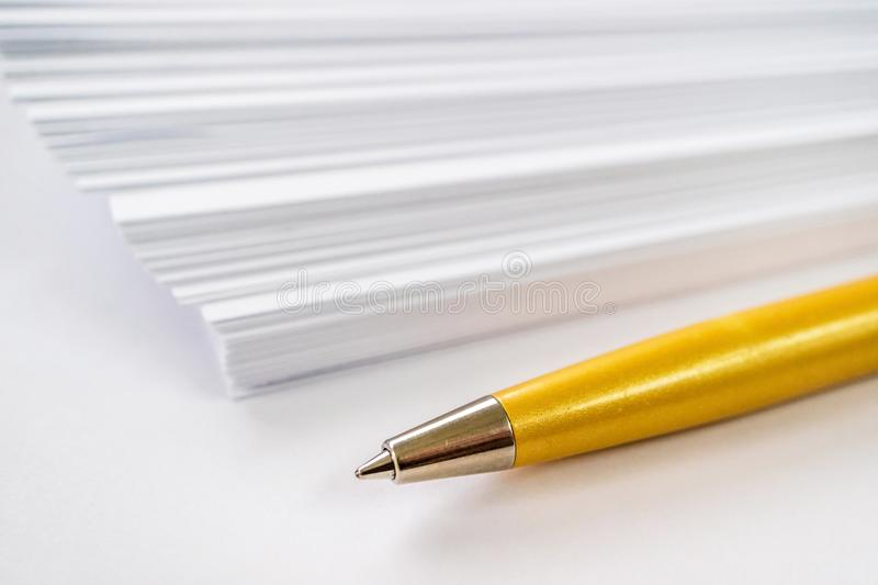 Ball point pen and blank paper, tools of the writer. White background royalty free stock photo