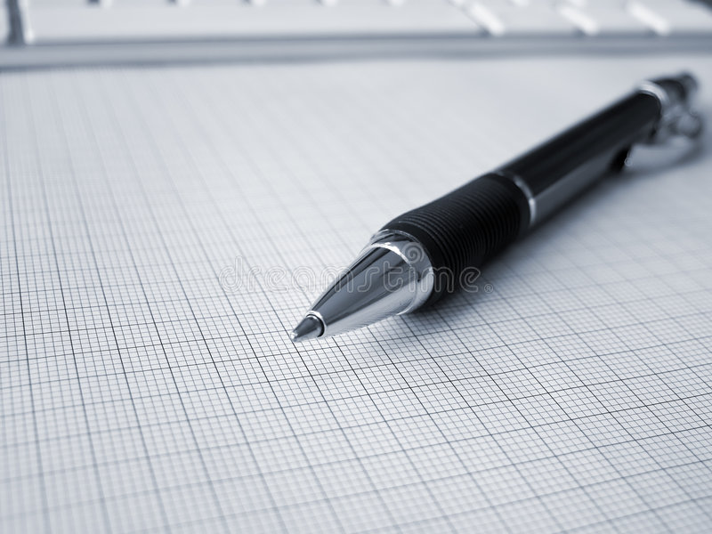 Ball-point pen on graph paper royalty free stock image