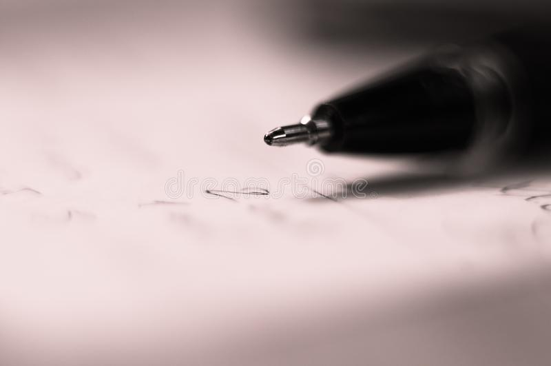 Ball point pen and a sheet of paper. With the inscription, macro, close up royalty free stock photo