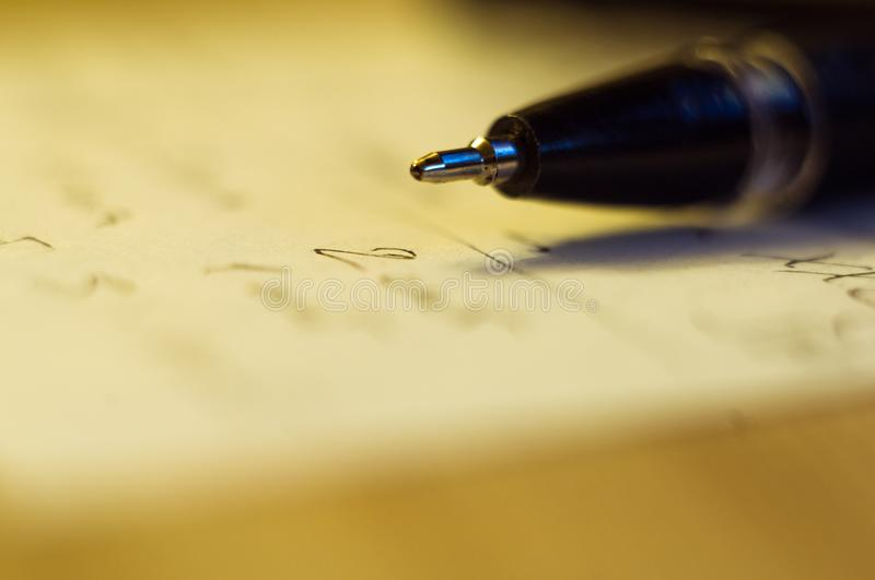 Ball point pen and a sheet of paper. With the inscription, macro, close up royalty free stock photography