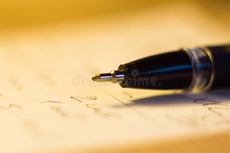 Ball point pen and a sheet of paper. With the inscription, macro, close up stock images