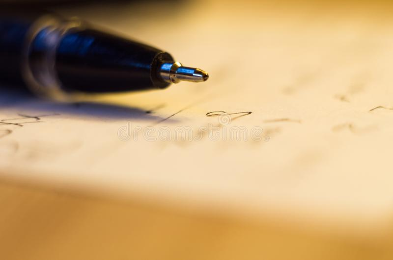 Ball point pen and a sheet of paper. With the inscription, macro, close up stock photography