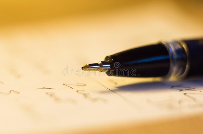 Ball point pen and a sheet of paper. With the inscription, macro, close up stock image