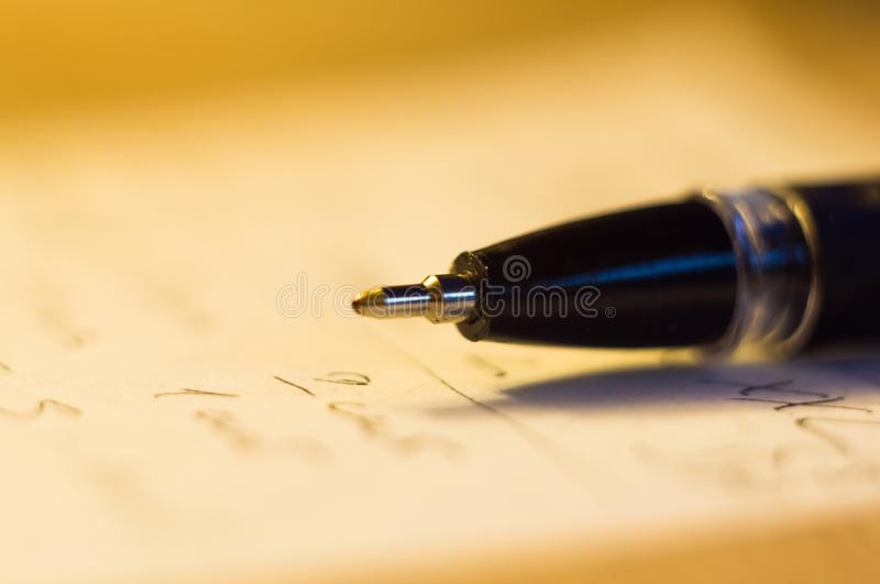 Ball point pen and a sheet of paper. With the inscription, macro, close up royalty free stock images