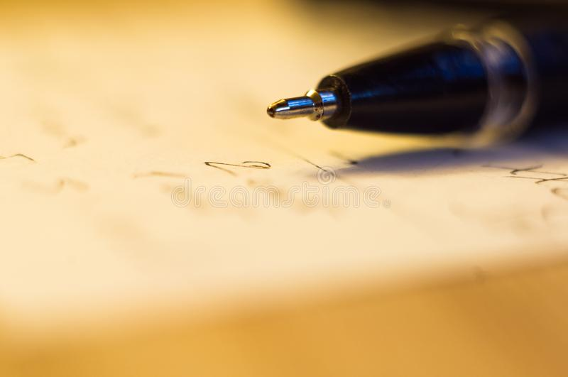 Ball point pen and a sheet of paper. With the inscription, macro, close up royalty free stock photos