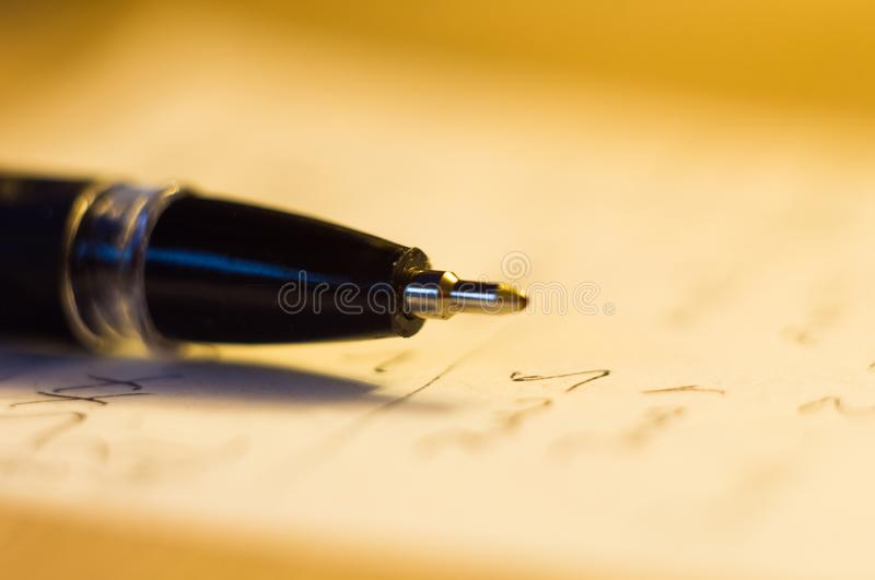 Ball point pen and a sheet of paper. With the inscription, macro, close up stock photo