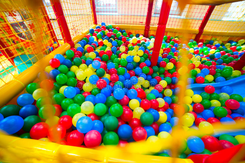 Ball pool in the playroom. Ball pool in the children's playroom royalty free stock images