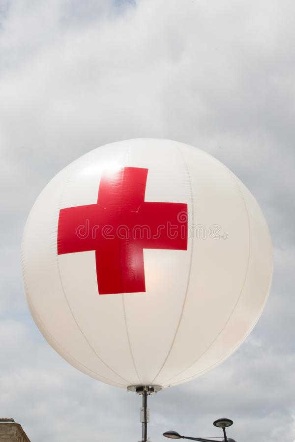 Balloon first aid red cross sign outside stock photography