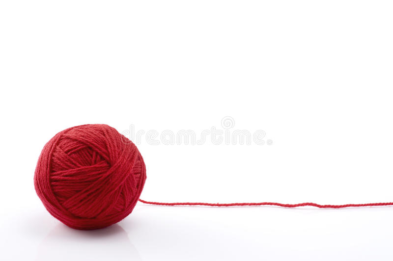 Ball of red yarn royalty free stock photos