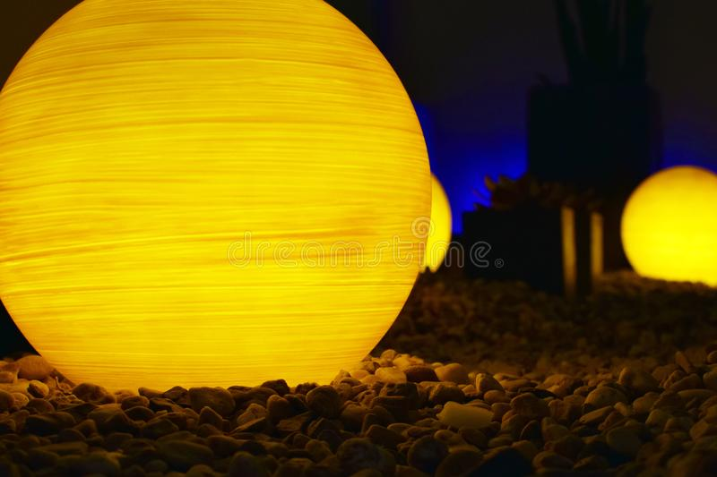 Ball shape lamps on stones royalty free stock photo