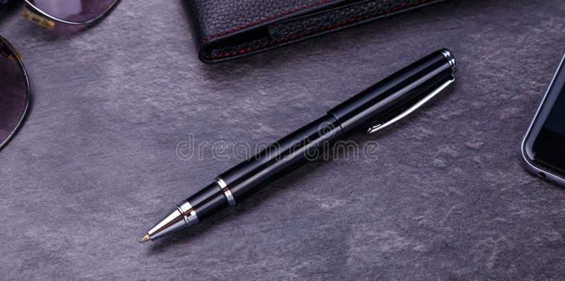 Ball shiny metal pen on black background. Luxury point pen closeup.  royalty free stock photos