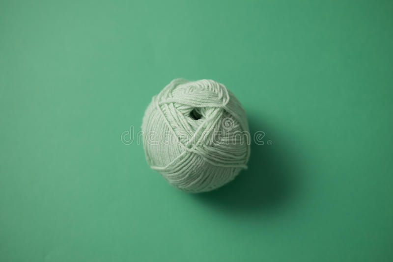 Ball of String On Top of Green Surface royalty free stock photo